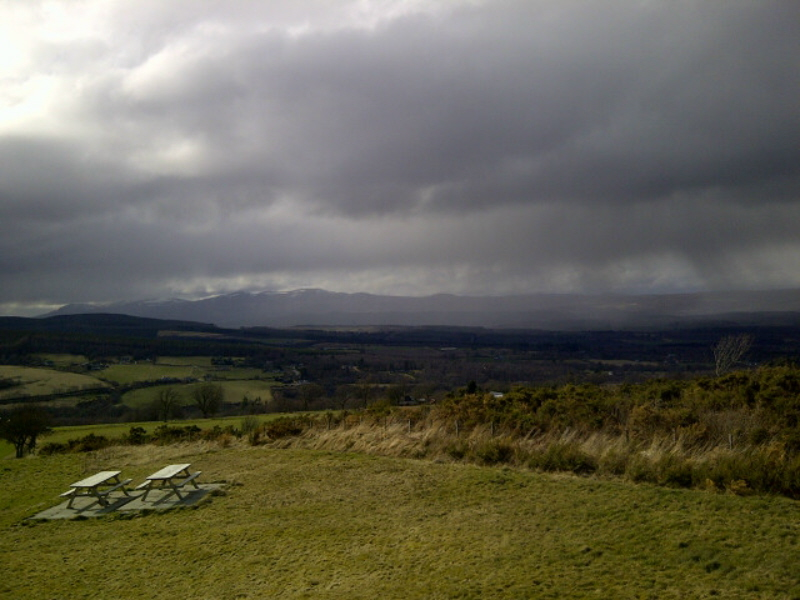web-sky-glowering-on-hills-feature